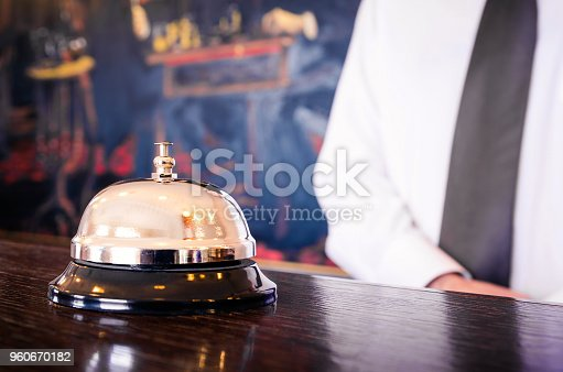 840883328 istock photo Hotel reception service bell with concierge 960670182