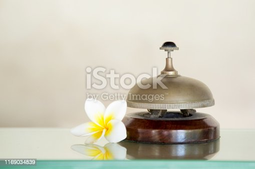 840883328 istock photo Hotel reception service desk bell, Hospitality industry concept 1169034839