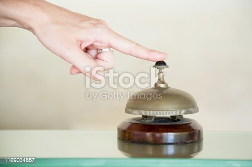 840883328 istock photo Hotel reception service desk bell, Hospitality industry concept 1169034857