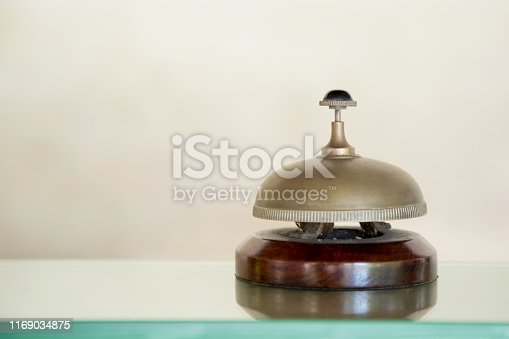840883328 istock photo Hotel reception service desk bell, Hospitality industry concept 1169034875
