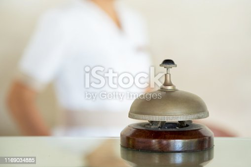 840883328 istock photo Hotel reception service desk bell, Hospitality industry concept 1169034885