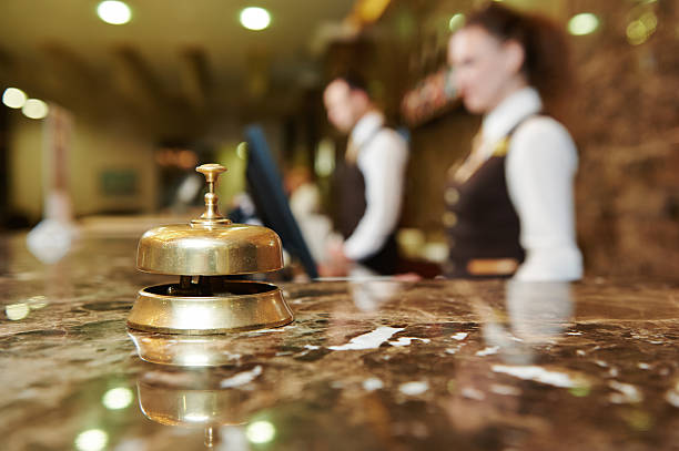Hotel reception with bell Modern luxury hotel reception counter desk with bell concierge stock pictures, royalty-free photos & images