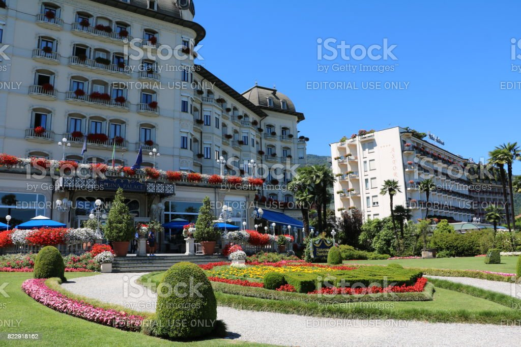 Hotel Regina Palace and Hotel Astoria in Stresa in front of the Borromean Islands at Lake Maggiore, Piedmont Italy stock photo