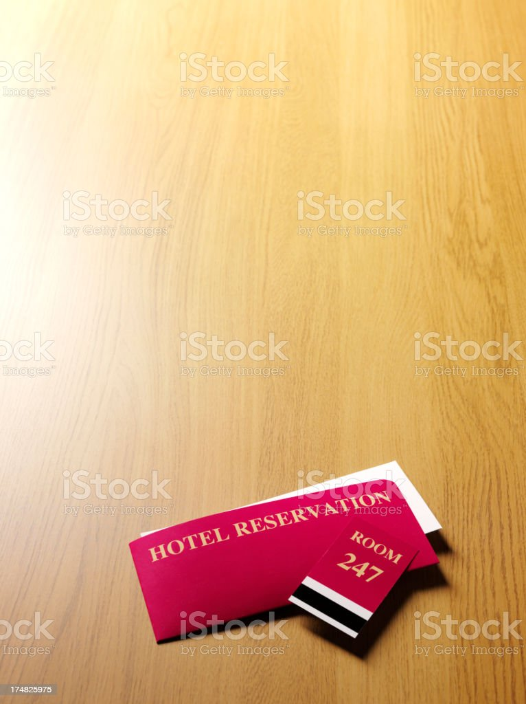Hotel Reservation Ticket with a Room Key royalty-free stock photo
