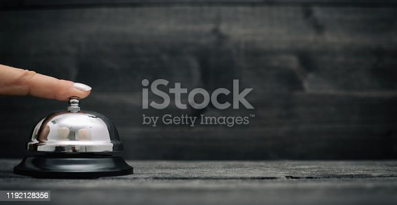 840883328 istock photo Hotel ring on black wooden  background 1192128356