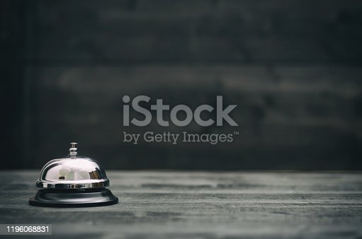 840883328 istock photo Hotel ring on black wooden  background 1196068831