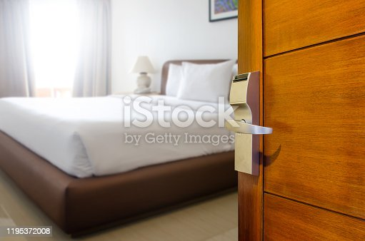 Hotel room , Condominium or apartment doorway with open door in front of blur bedroom background, Copy space image or text