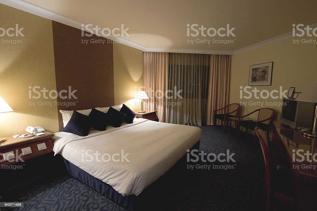 Hotel room in evening stock photo