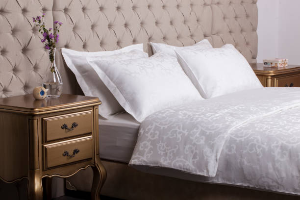 Hotel room interior detail from bed stock photo