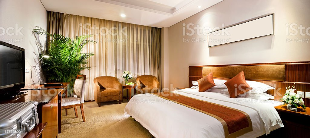 Hotel room interior featuring the bed stock photo