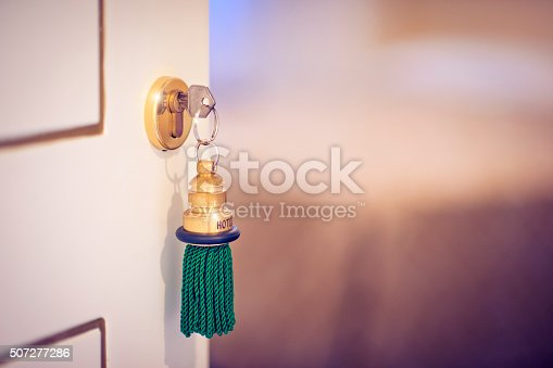 A key in a door to a hotel room