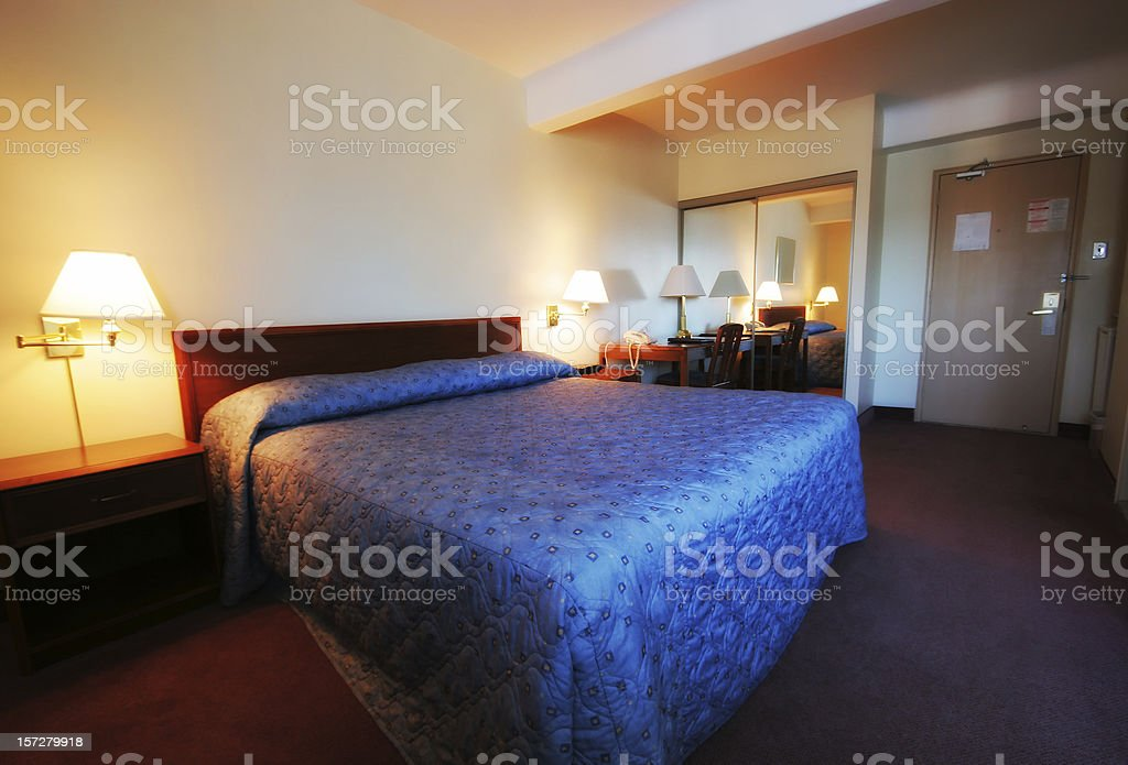 Hotel room with a double bed royalty-free stock photo
