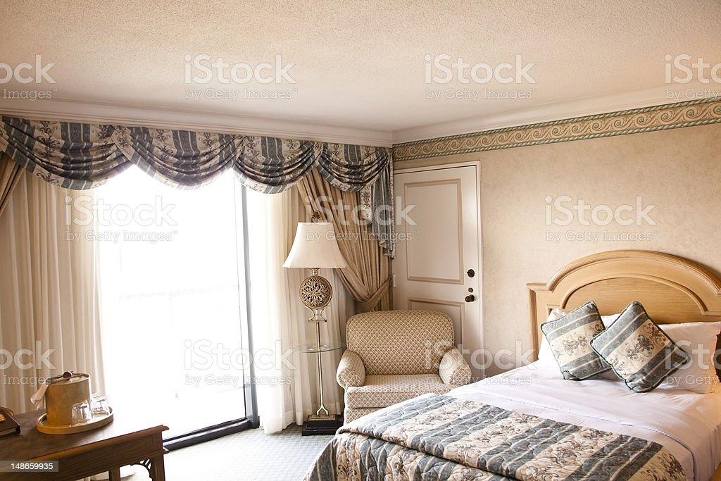 Hotel Room with bed chair and desk royalty-free stock photo