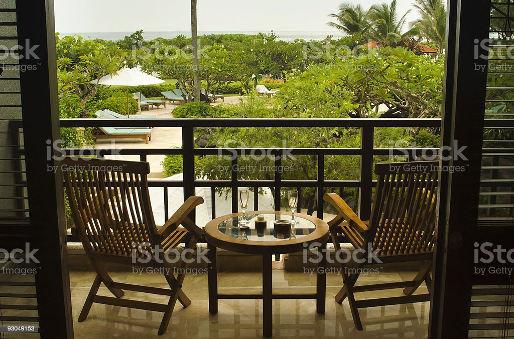 Hotel room with private balcony and ocean view royalty-free stock photo