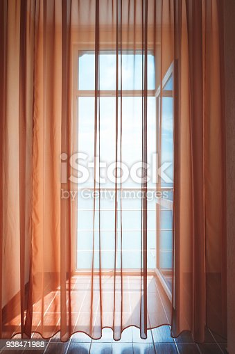 istock Hotel room with sea view house near sea in environmental  location on  island. window overlooking the ocean. endless expanse of  sea. Place romantic holiday. Blurred toning in vintage dreamy style. 938471988