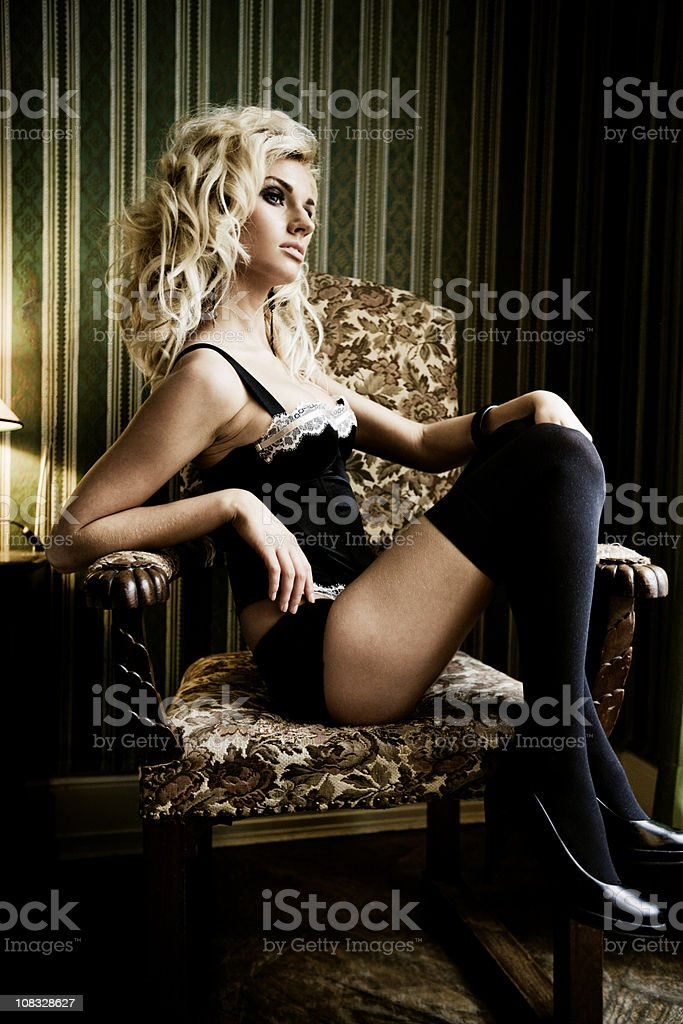 Hotel Room Woman in Lingerie looking out the Window royalty-free stock photo
