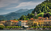 Bellagio, Italy-May 29, 2011-A row of elegant and comfortable hotels greet visitors as they arrive by boat to the Lake Como town of Bellagio