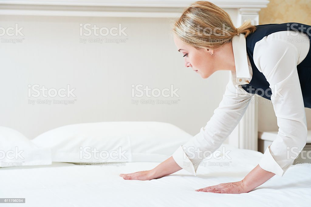 Hotel service. Made making bed in room stock photo