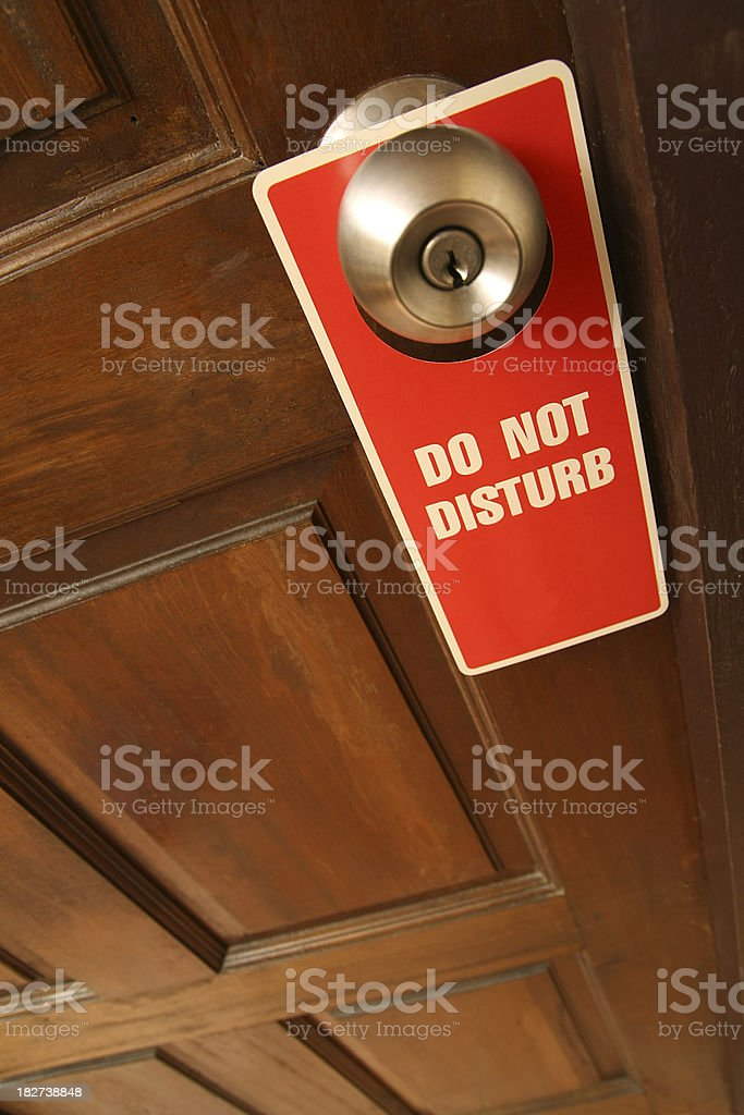 Hotel Sign on Doorknob , Do Not Disturb royalty-free stock photo