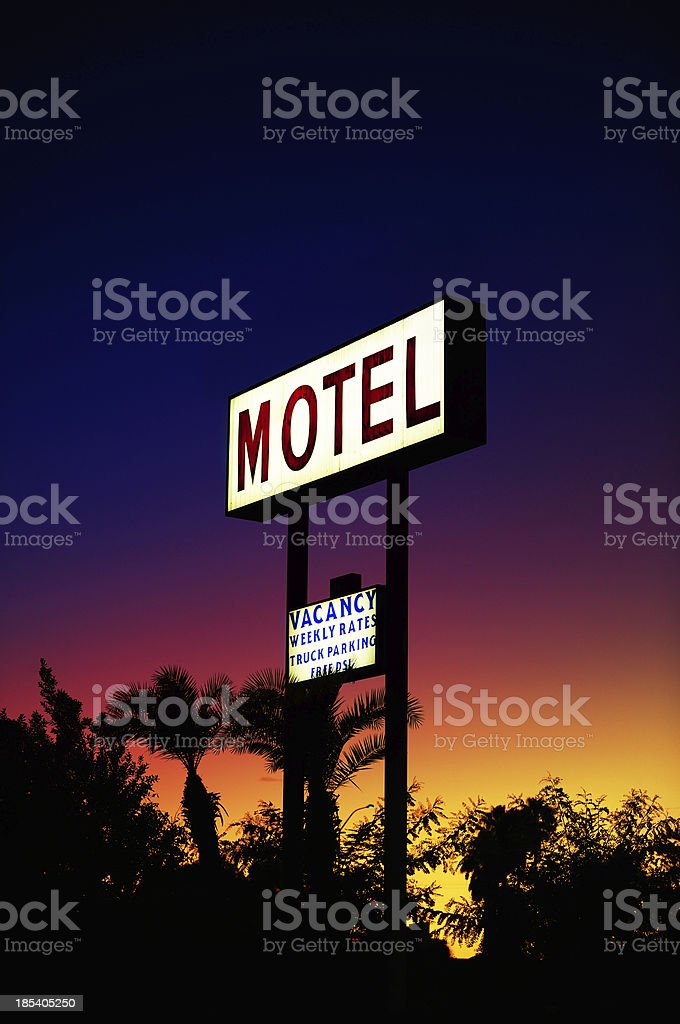 Hotel sign over sunset trees royalty-free stock photo