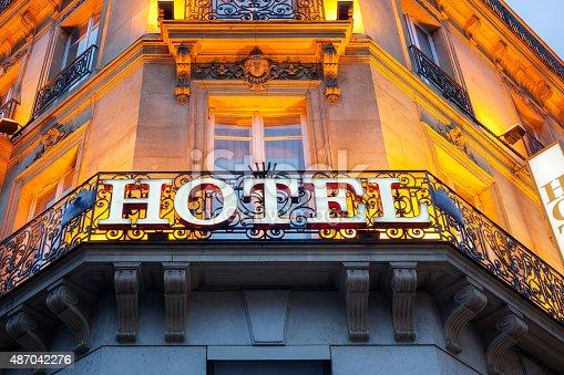 Illuminated hotel sign taken in Paris at night