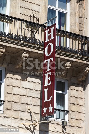 Hotel sign road at the entrance of cozy accommodation in European city
