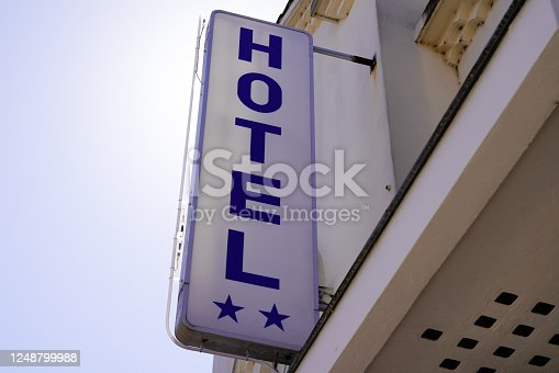 Hotel sign text with two stars in vintage retro on Building in tourist city