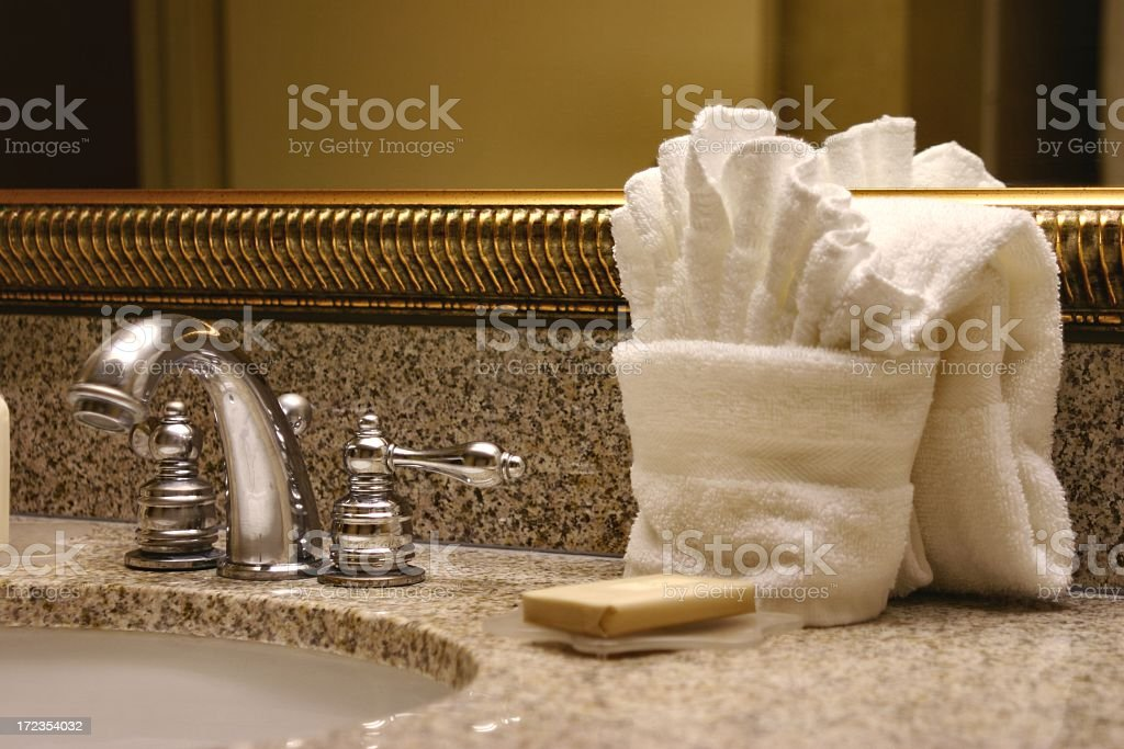 Hotel Sink with towels, mirror, soap and faucet royalty-free stock photo