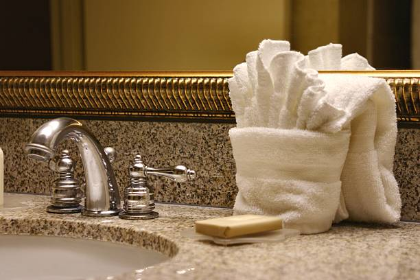 Hotel Sink with towels, mirror, soap and faucet stock photo
