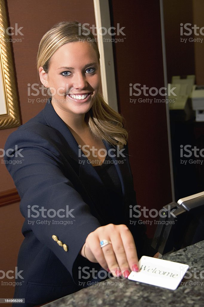Hotel Smile with Welcome card stock photo