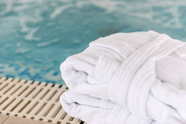 Hotel, spa, swimming pool, bathrobe, towels stock photo