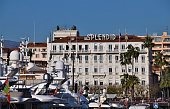 Cannes, France - January 1 2020: Hotel Splendid and Old Port of Cannes daytime with clear blue sky