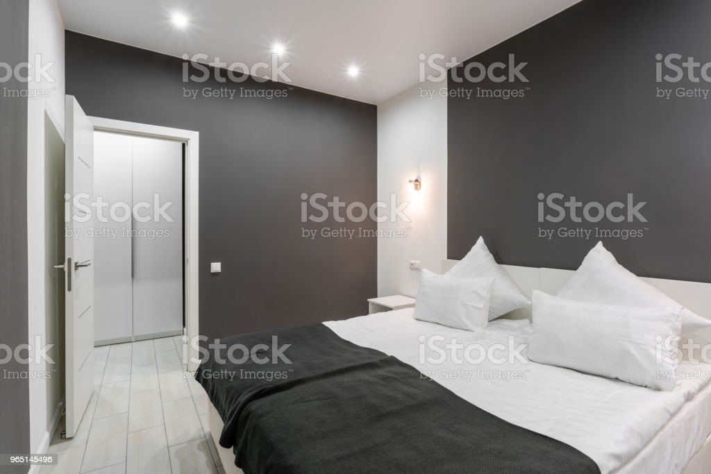 Hotel standart room. modern bedroom with white pillows. simple and stylish interior. interior lighting royalty-free stock photo