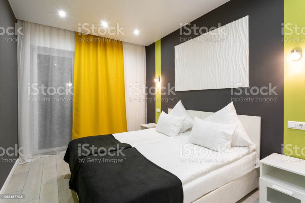 Hotel standart room. modern bedroom with white pillows. simple and stylish interior. interior lighting zbiór zdjęć royalty-free