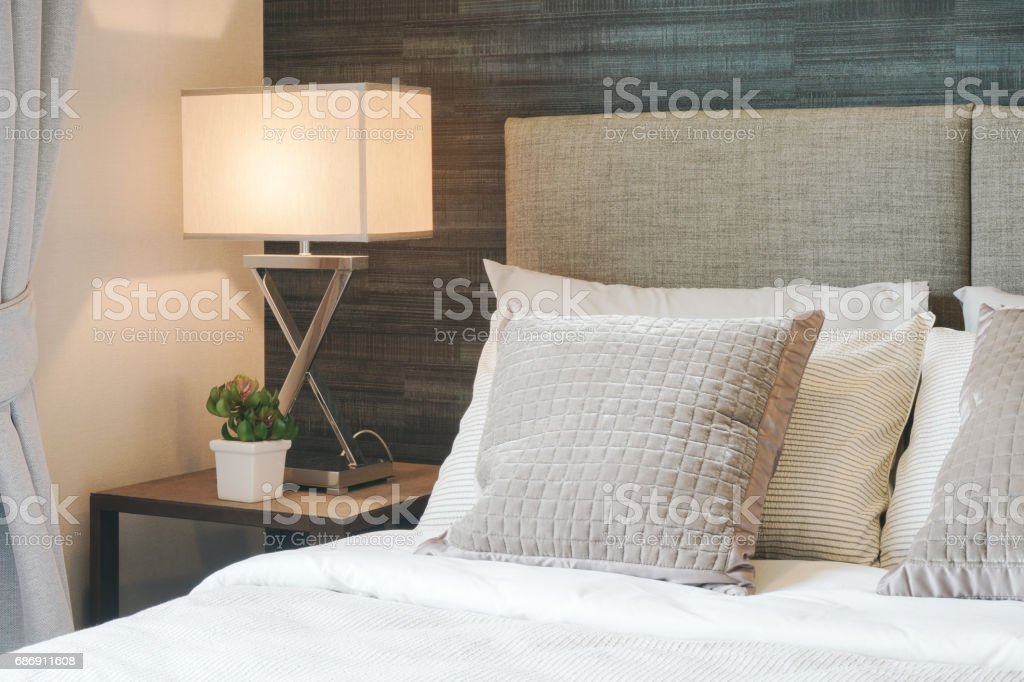 Hotel style bedding with white shade reading lamp stock photo