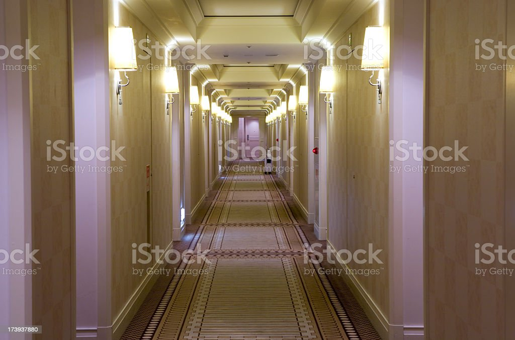 Hotel style, cream colored hallway with lamps royalty-free stock photo