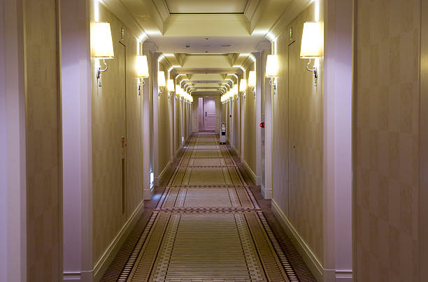 Hotel style, cream colored hallway with lamps stock photo