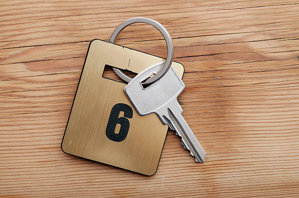 Hotel suite key with room number 6 on wood table stock photo