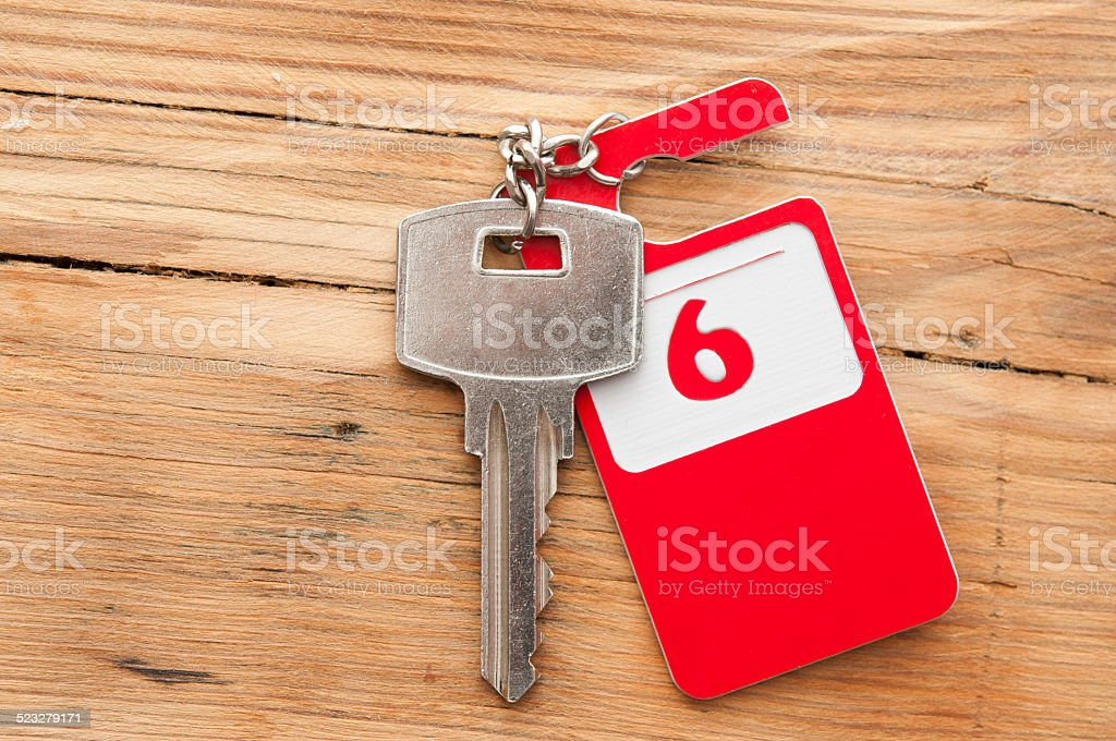 Hotel suite key with room number 9 on wood table stock photo