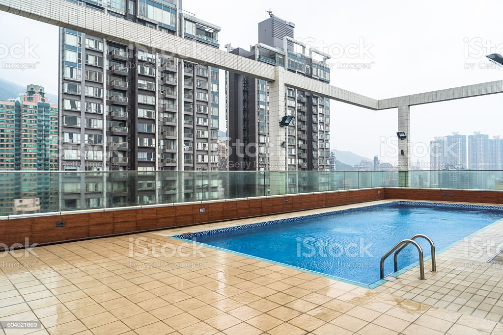 hotel top swimming pool with residential apartments background stock photo