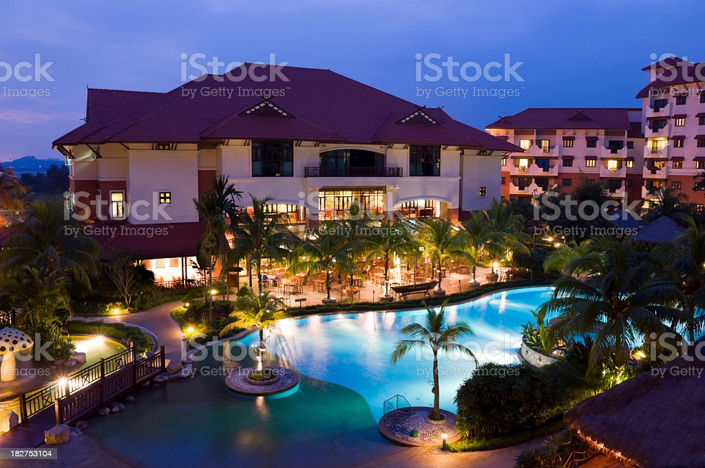 Hotel with pool and palm trees royalty-free stock photo