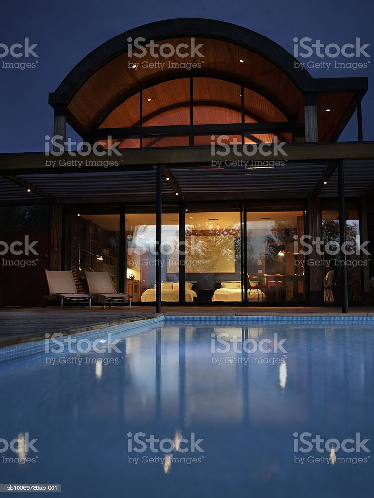 Hotel with swimming pool at night royalty-free stock photo