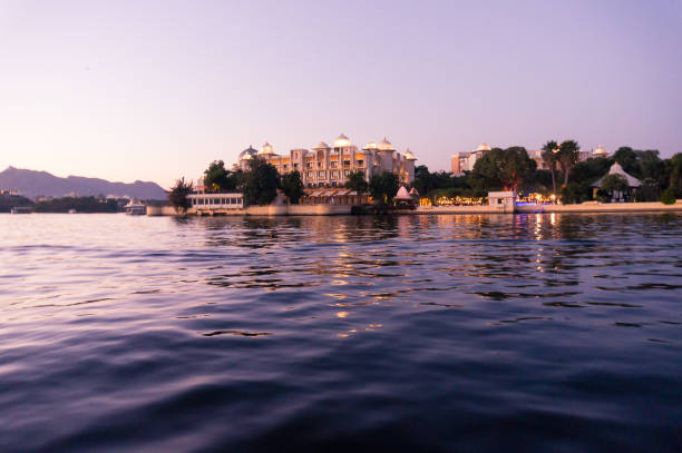 Hotels on the banks of lake pichola udaipur at dusk Hotels on the banks of lake pichola udaipur at dusk. The beautiful lake city of Udaipur offers many modern and traditional hotels for stay. lake pichola stock pictures, royalty-free photos & images