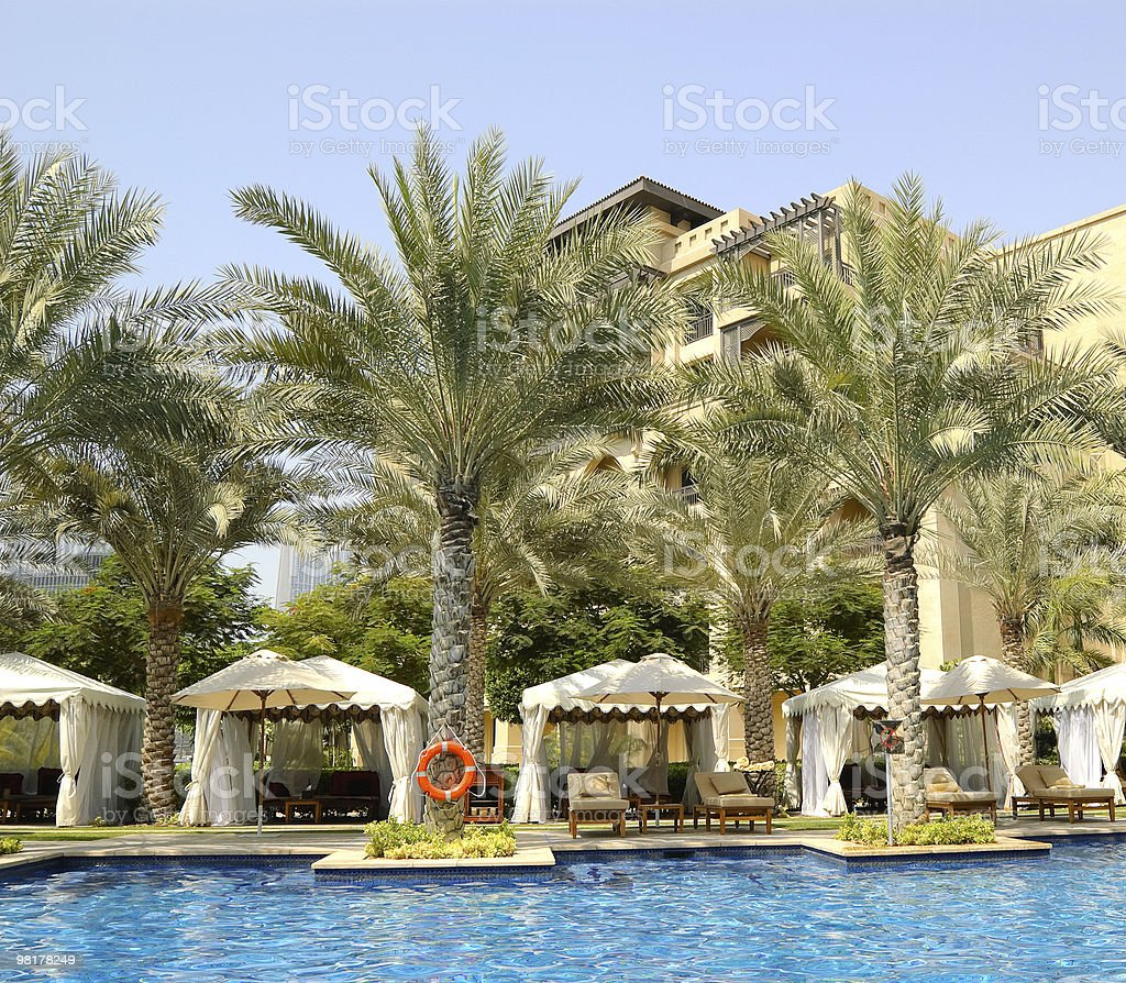 Hotel's swimming pool area in Dubai downtown, UAE royalty-free stock photo
