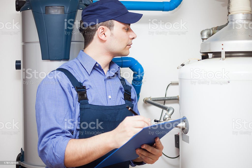 Hot-water heater service stock photo
