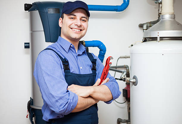 Hot-water heater service Technician servicing an hot-water heater pipefitter stock pictures, royalty-free photos & images