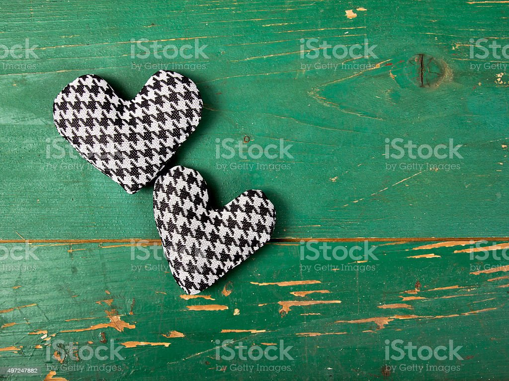 houndstooth hearts on a green background stock photo