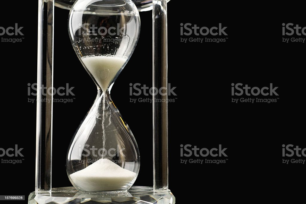 Hour Glass Sand Falling on Black Marking Time royalty-free stock photo