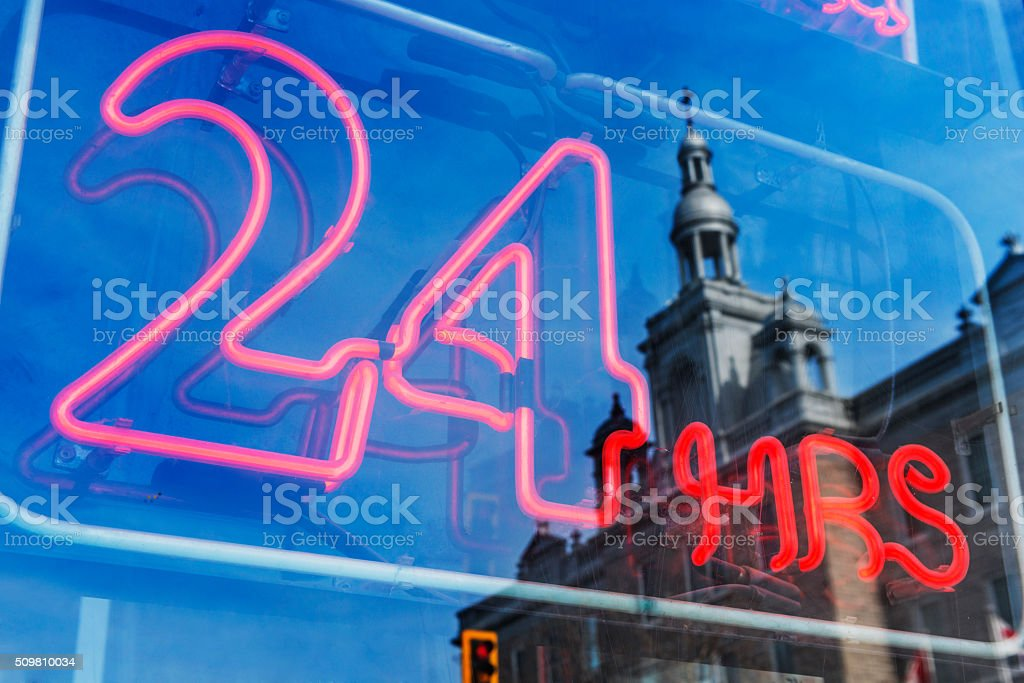 24 Hour Neon Sign in Montreal Business Window stock photo