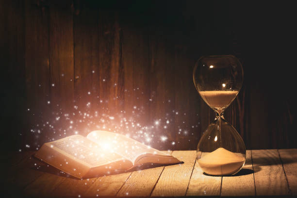 Hourglass and Holy Bible stock photo